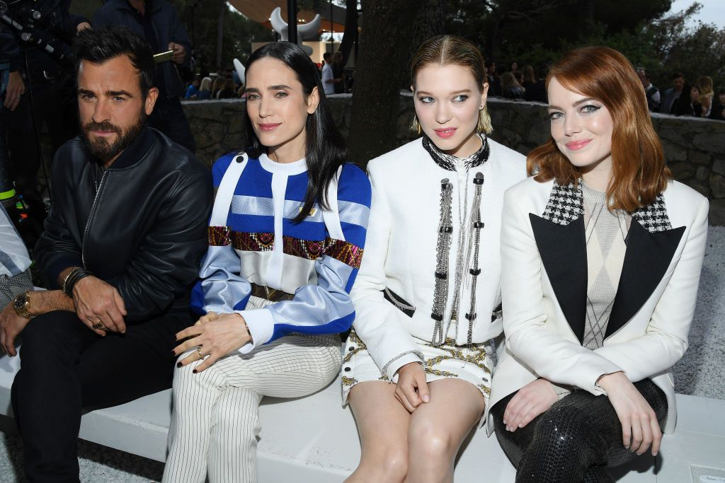 Emma Stone and Justin Theroux at the Louis Vuitton cruise show.