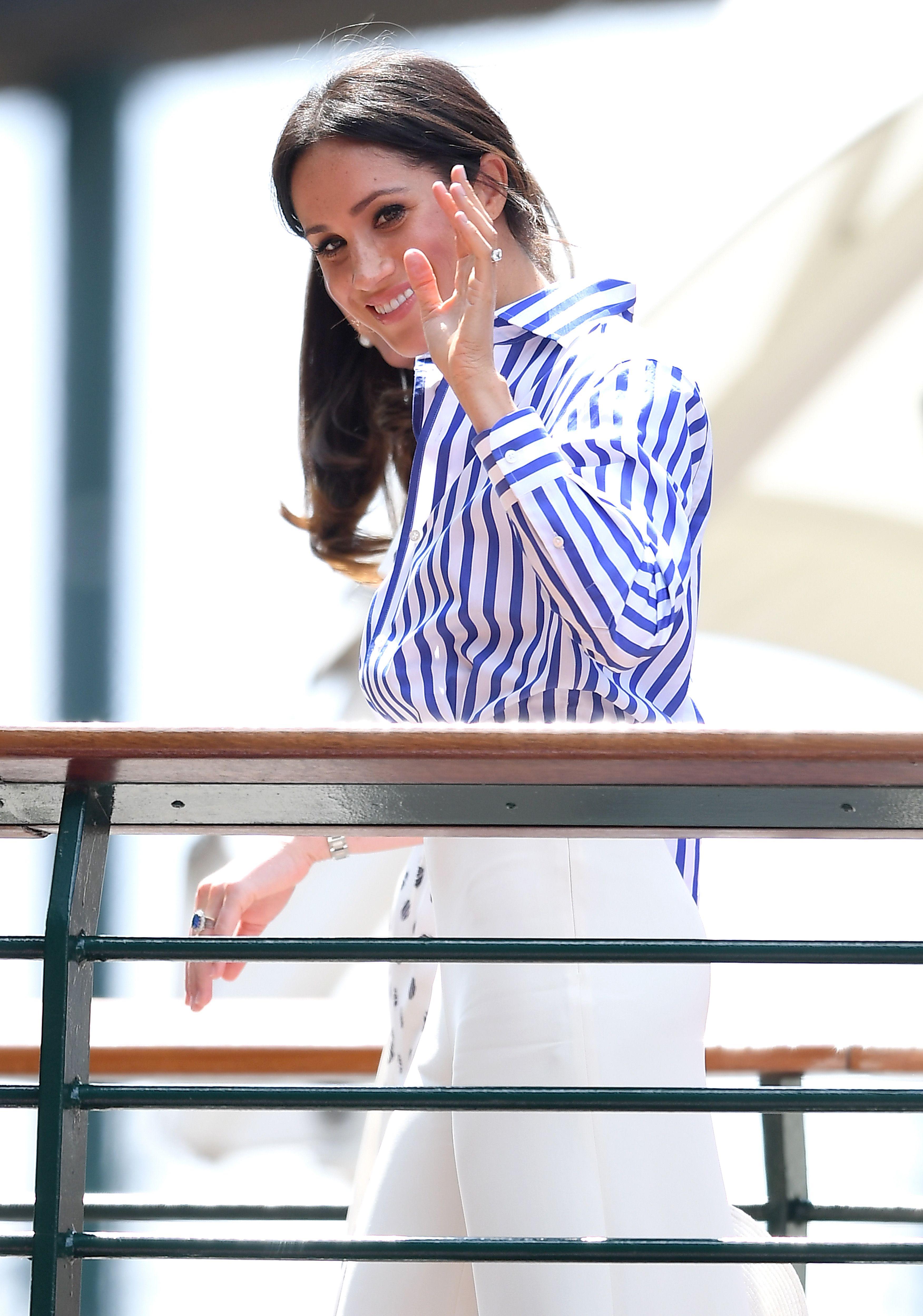 Meghan Markle Wears Striped Shirt White Pants to Watch