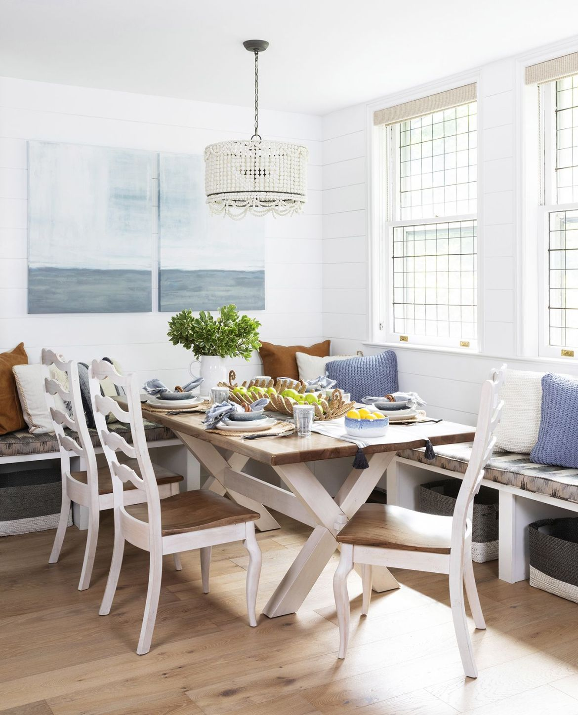 home featuring warm neutrals and soothing blue hues to accent the beautiful architecture of the vintage home interior designer karen b wolf dining room, breakfast nook