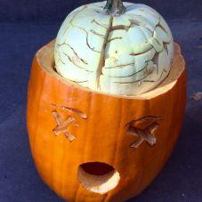 a halloween pumpkin with a brain