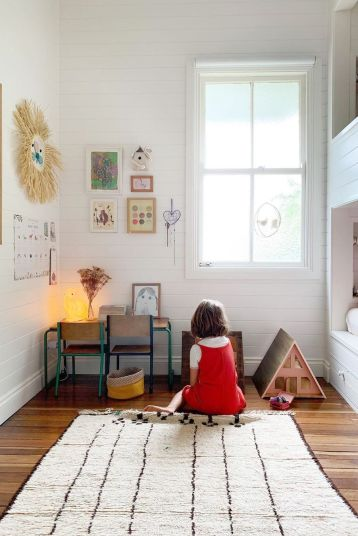 little kid playing with dollhouse