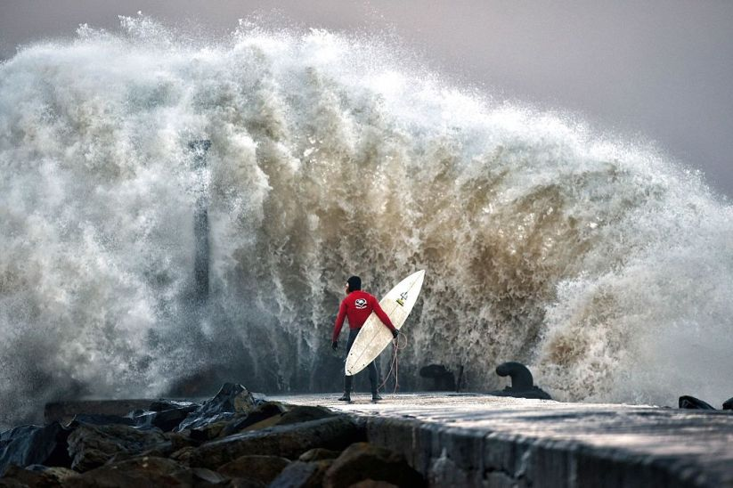 A Pro-surfer Waits For A Break In The Surge
