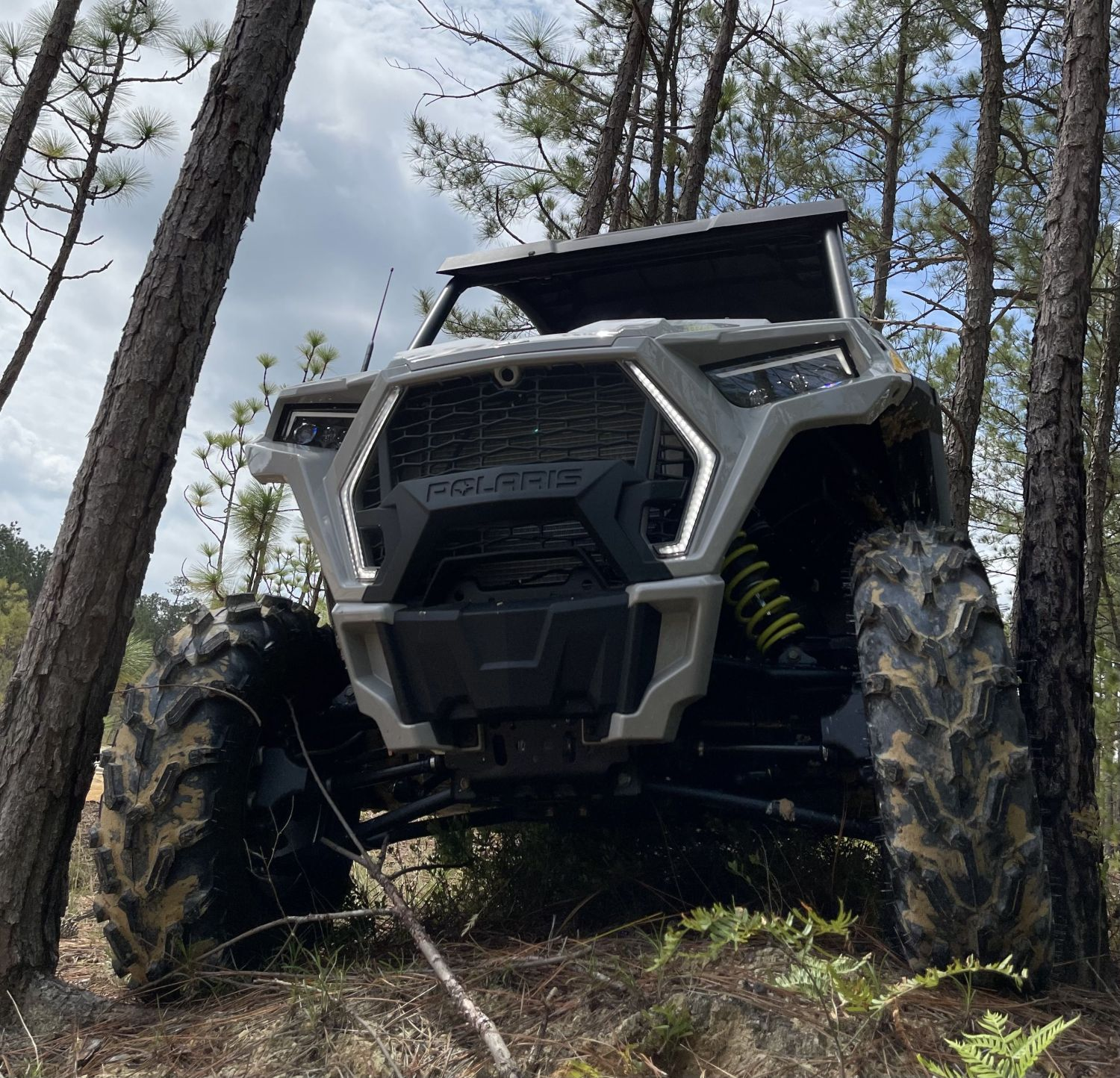 rzr trail squeezing between two trees