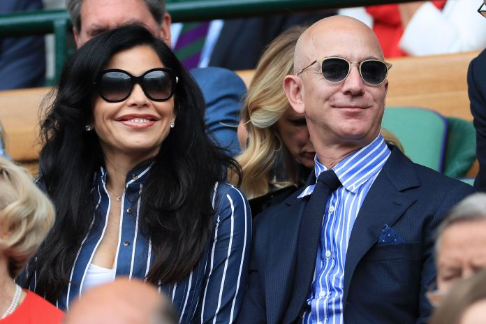 london, england july 14 jeff bezos and his partner, lauren sanchez, look on from the royal box on center court on day 13 of the championships wimbledon 2019 at the all england lawn tennis and croquet club on july 14, 2019 in london, england photo by simon stacpooleoffsidegetty images