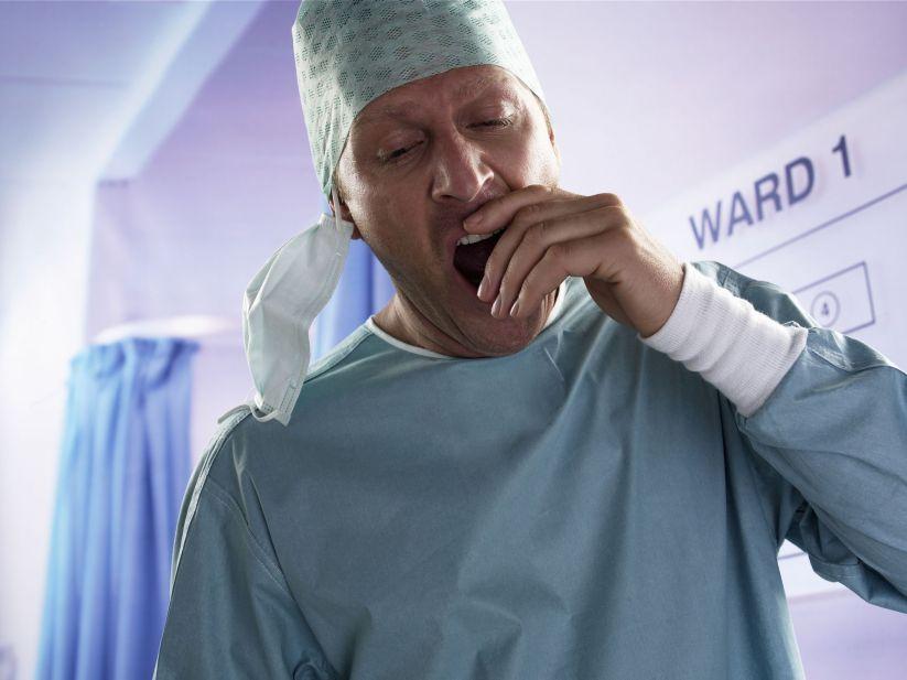 Male surgeon yawning, close-up