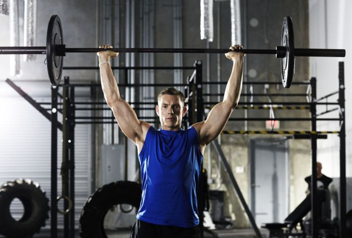 Man lifting barbell above his head