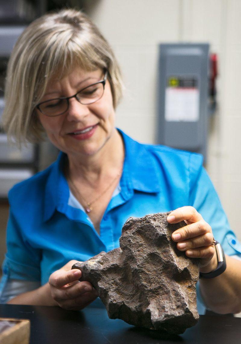 Professor Monaliza Sirbescu shows off a meteorite.