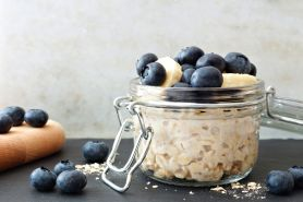 Overnight oats with blueberries and bananas, with white and black background