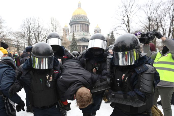 police officers detain a protester during a rally in support of alexei navalny politica in st petersburg, russia, on january 23, 2021 opposition politician alexei navalny has returned after poisoning from germany to russia and was detained at the airport in moscow photo by valya egorshinnurphoto via getty images