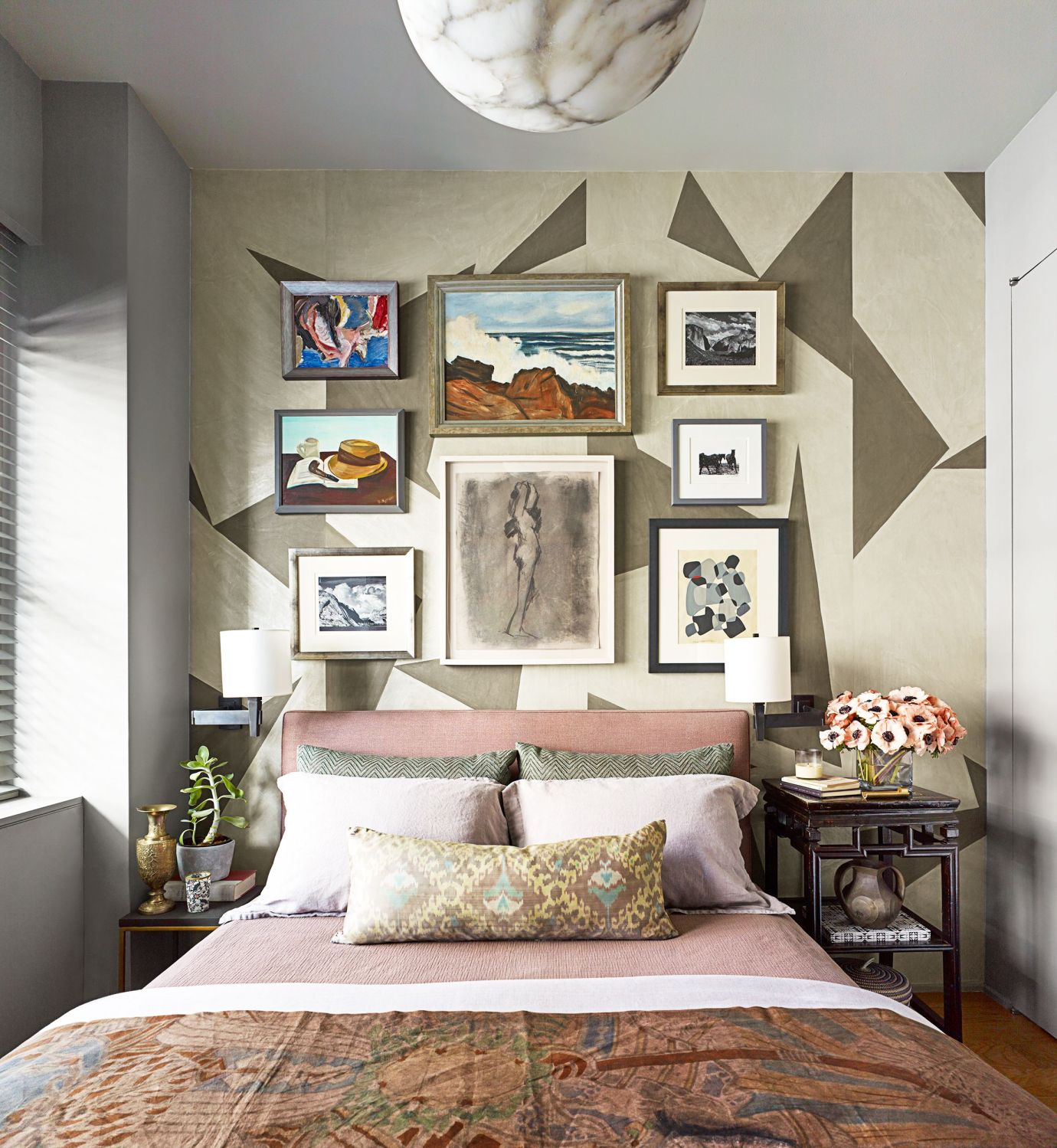bedroom with geometric wallpaper