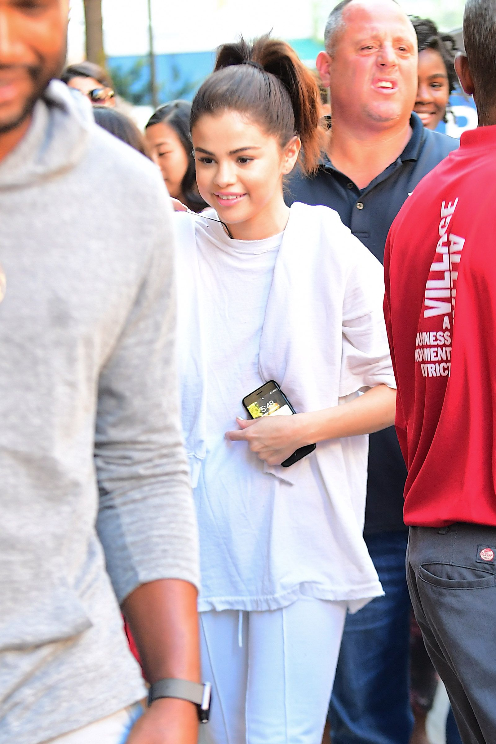 Selena Gomez out with The Weeknd on her phone background.