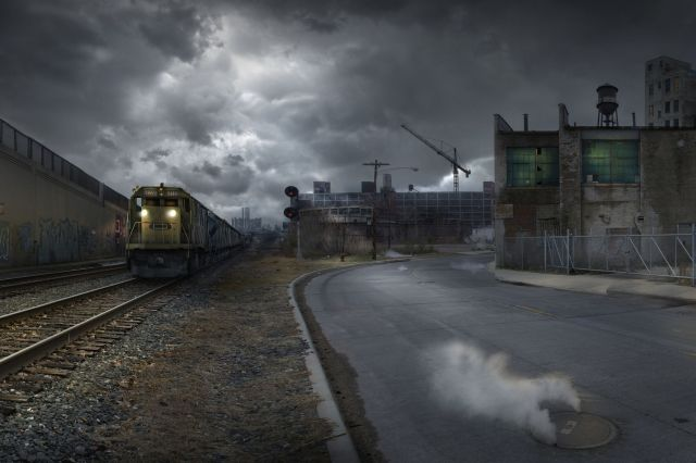 train on train tracks in dilapidated industrial city