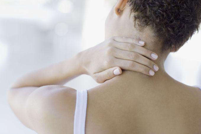 woman holding neck neck pain