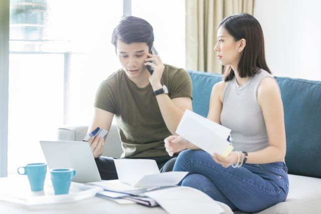 Worried couple struggle to pay credit card debt
