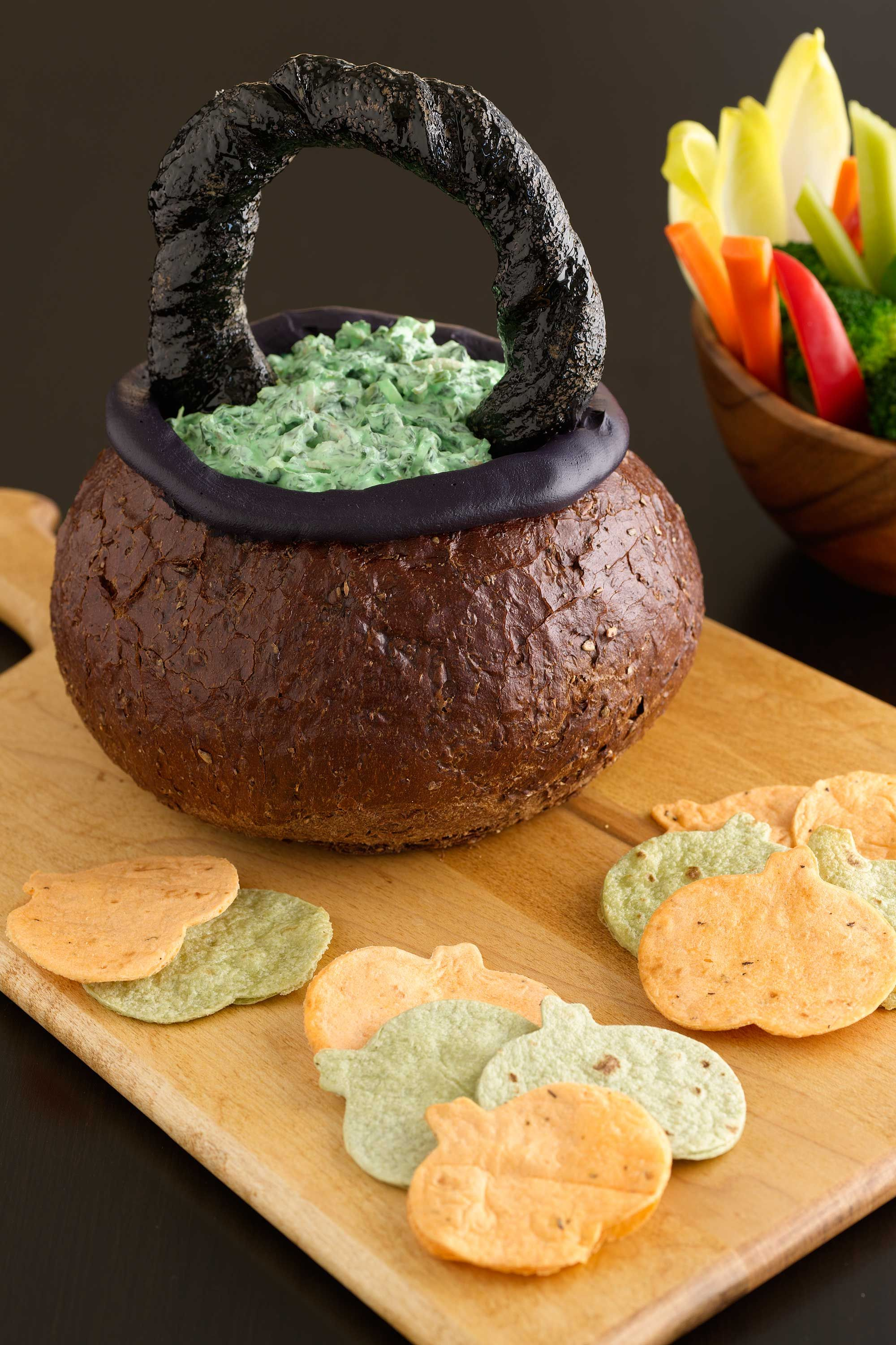 Liven up your home's curb appeal by decorating for the holiday season, starting with halloween. Spooky Spinach Dip in Bread Bowl Cauldron