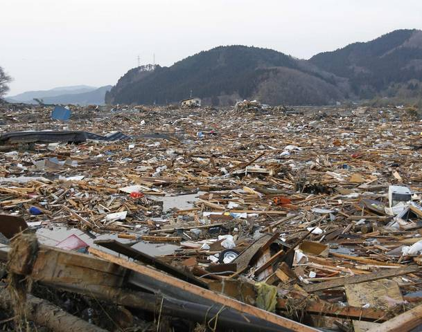 A general view shows the devastation as rescue workers search for victims in the rubble after the March 2011 magnitude 9.0 earthquake and tsunami in Rikuzentakata, northern Japan