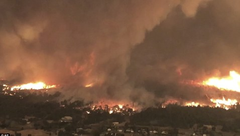 Horrifying footage shows colossal FIRENADO the size of three football fields that killed a firefighter battling monster California wildfire