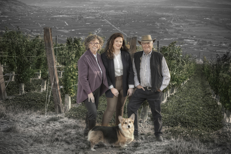 Elaine, Sara and Don Triggs (and Barry the Corghi) on their recently sculpted and now planted high Okanagan bench, image supplied