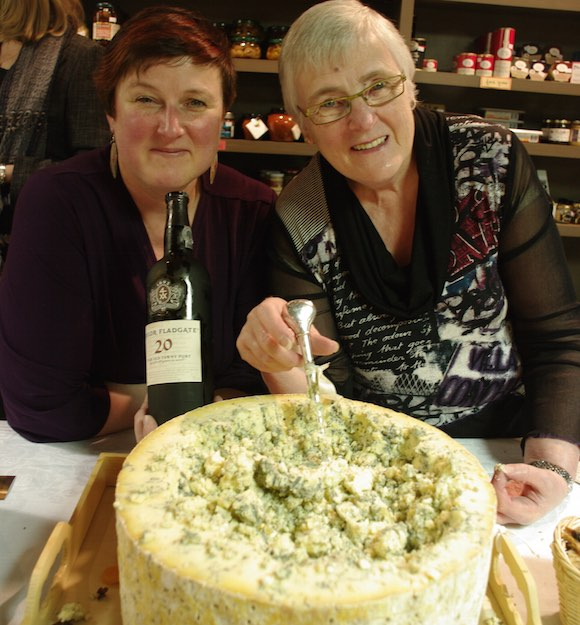 Cheese specialsts Alison and Alice Spurrell with massive wheel of Stilton