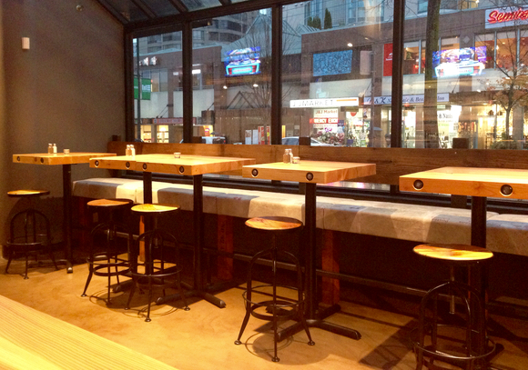 Timber's wide choice of seating includes banquettes and stools overlooking Robson St