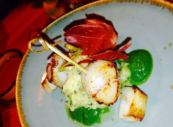 Scallops with parsley, celeriac & jamon Serrano with sweet potatoes