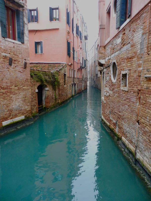 Venice narrow canal and bricks