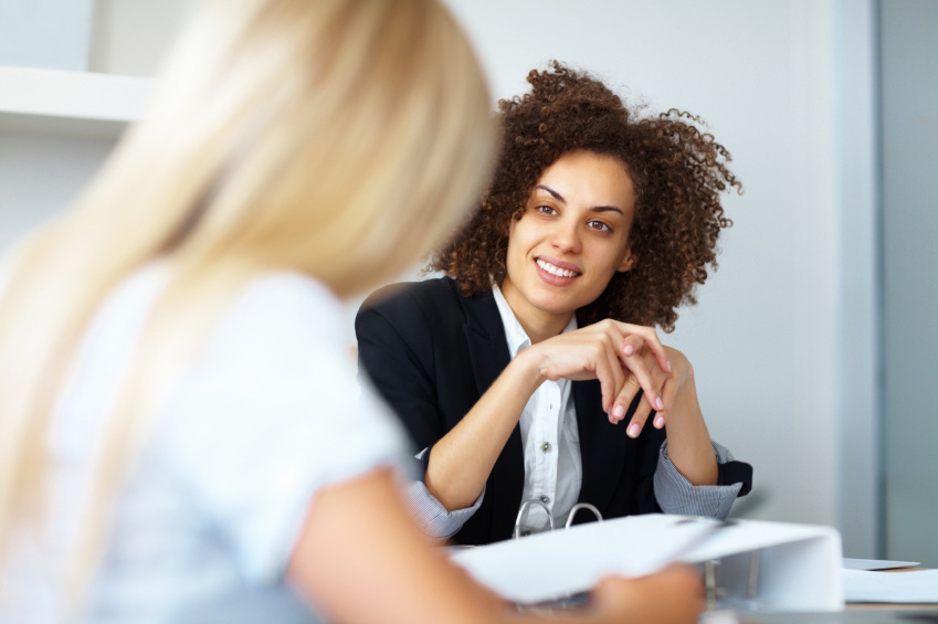 Image result for two women talking in office