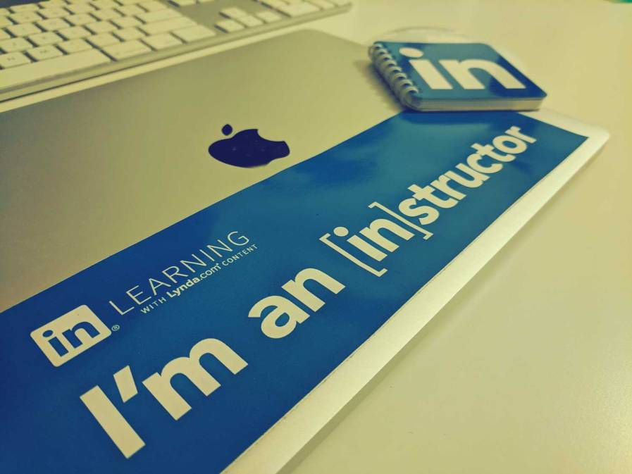 "Macbook with a sticker that says ""I'm an LinkedIn Learning Instructor"""