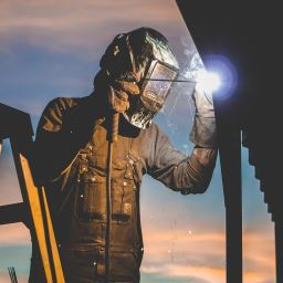 Welder at construction site
