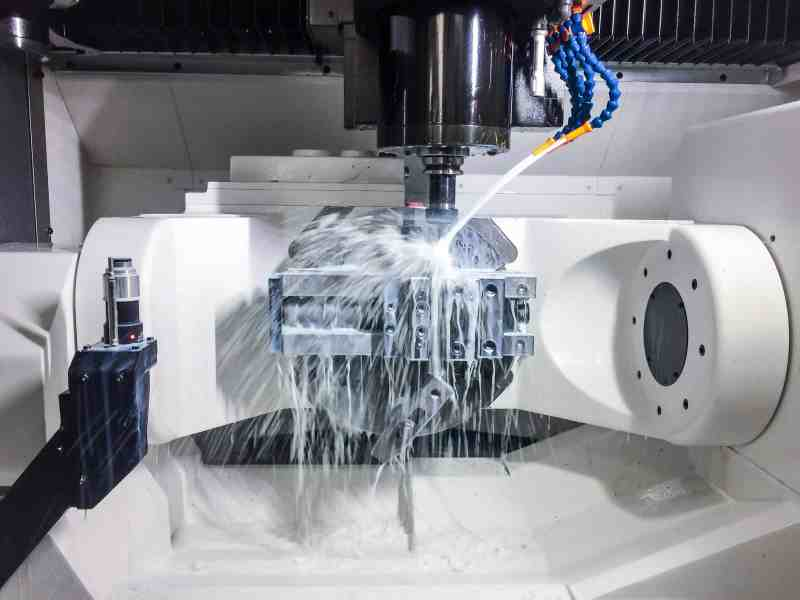 5-axis CNC milling machine cutting a part