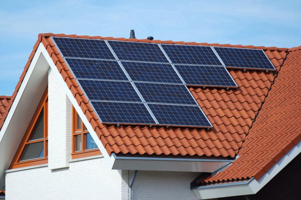 Roof top with solar panels for green energy.