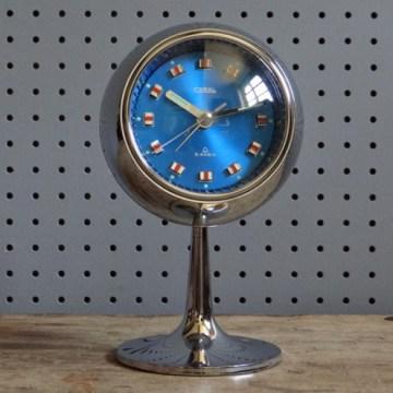 Coral pedestal alarm clock