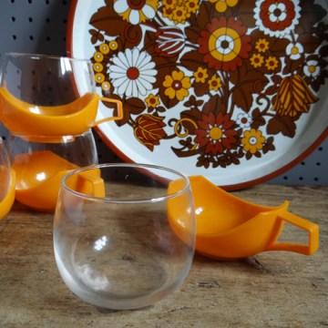 Orange hot mugs with tray
