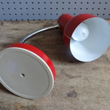 Red goosenecked desk lamp
