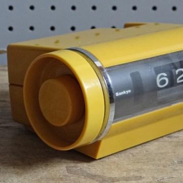 yellow Sankyo radio alarm clock
