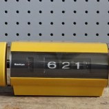 yellow Sankyo radio alarm clock