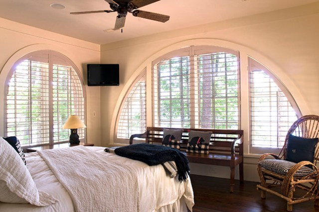 Half moon windows with custom made shutters