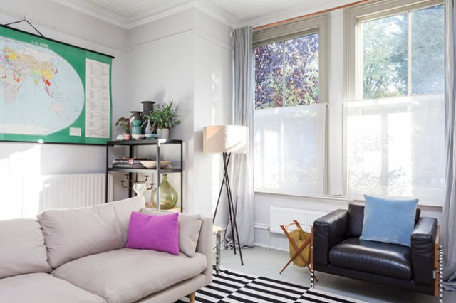 Sitting room with white bottom up blinds