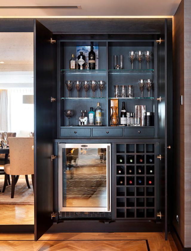 Cupboard home bar painted grey with integral bar fridge and wine rack
