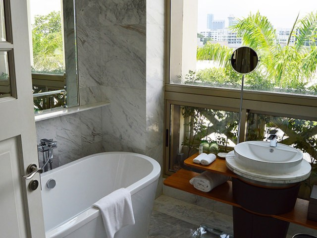 Compact bathroom with marble-clad walls