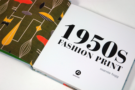 "front page from the book entitled ""1950s Fashion Prints"" by Marnie Fogg surrounded by vintage 1950s fabric"