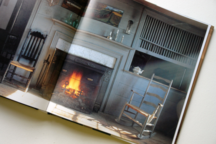 """page showing an antique chair in front of an open fire from """"The Way We Live In the Country"""" by Stafford Cliff & Gilles de Chabaneix"""