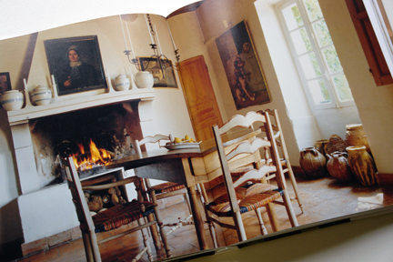"""page showing dining table & chairs in front of an open fire from """"The Way We Live In the Country"""" by Stafford Cliff & Gilles de Chabaneix"""