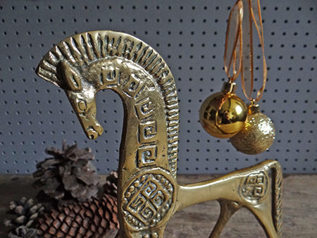 Vintage brass horse figure with pine cones and Christmas baubles