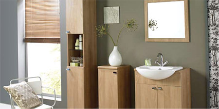 modern bathroom with light wood furniture and moss green wall
