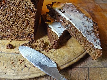 Sliced & buttered home-made black bread loaf