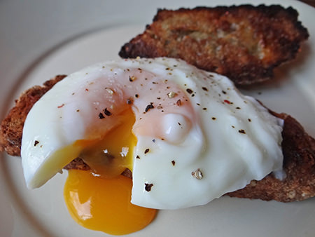 poached eggs on sliced & toasted cheese soda bread