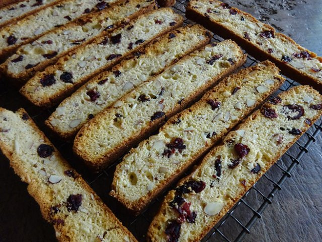 Cranberry almond biscotti cooling on a wire rack | H is for Home