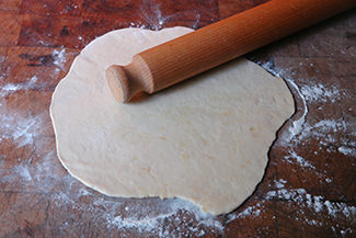 Rolling out flatbread dough into rounds | H is for Home