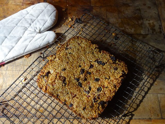 Home-made fruit and nut flapjack cooling on a wire rack | H is for Home